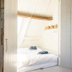 Sfeervolle slaapkamer van Toplocatieszeeland.nl